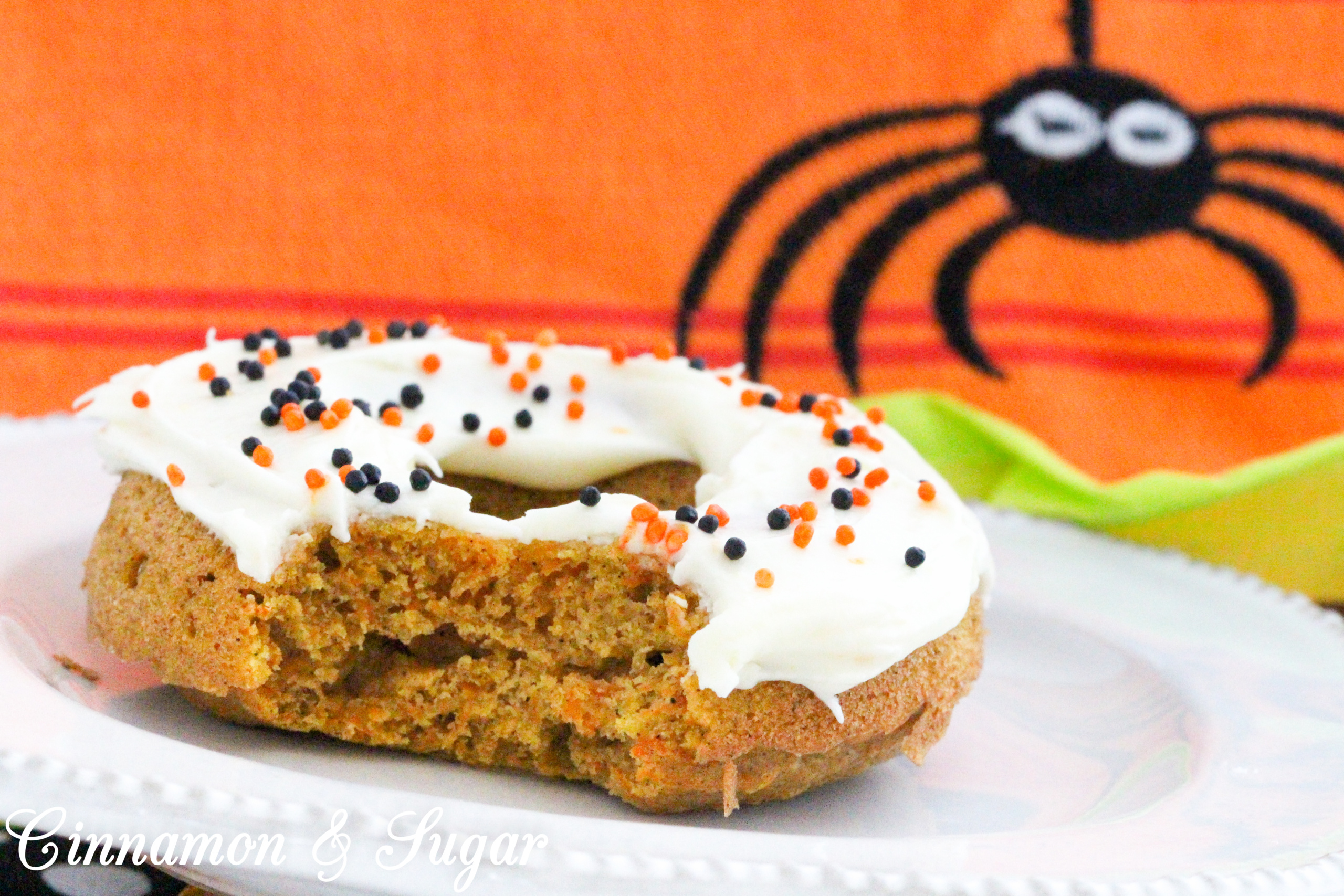 Scare-It Cake Donuts are a riff on Carrot Cake! Filled with warm, autumn spices and a generous portion of grated carrots to keep them extra moist, these donuts are a treat for all gouls and goblins! Recipe shared with permission granted by Ginger Bolton, author of BOSTON SCREAM MURDER.