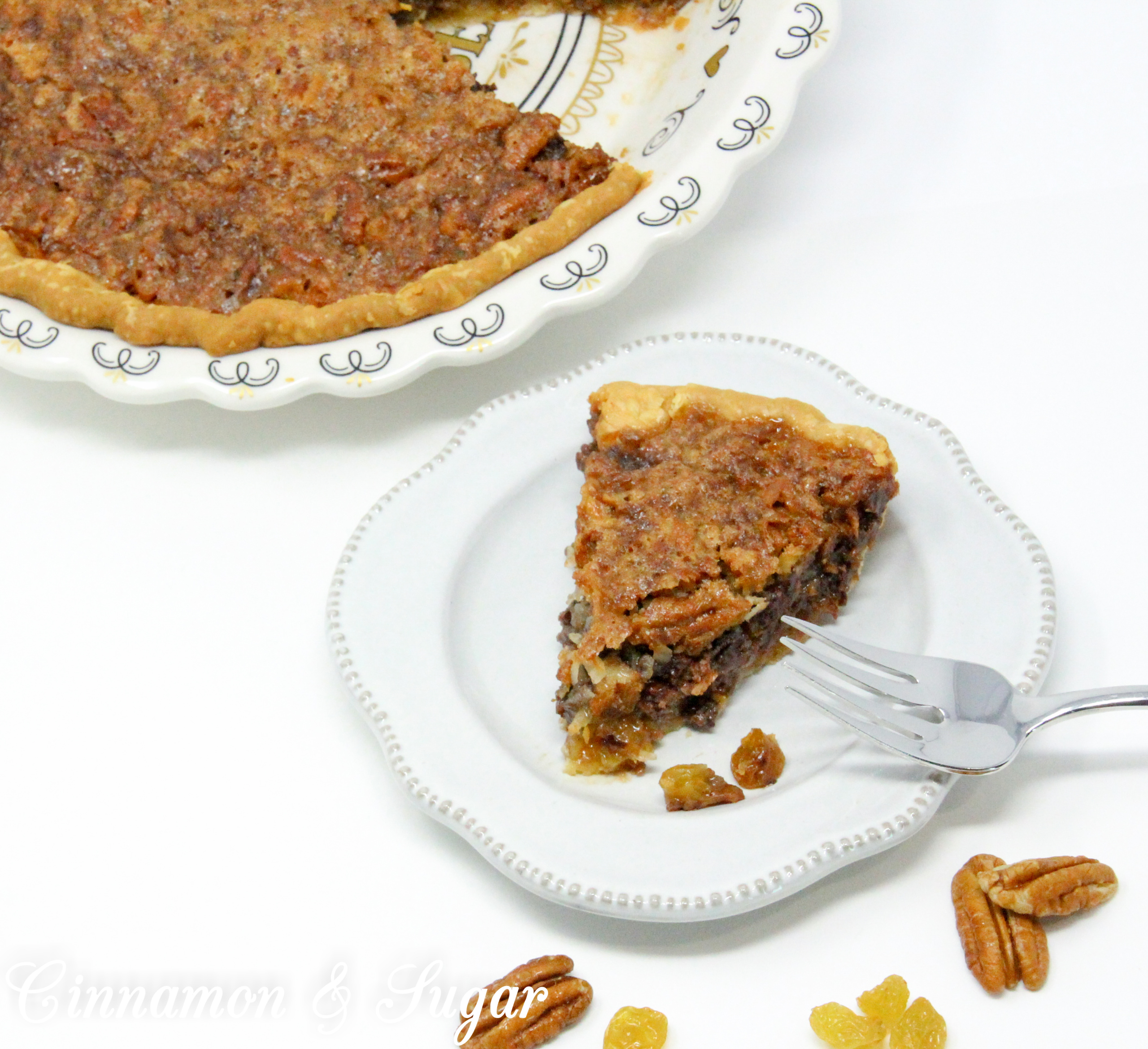 With a base similar to pecan pie, the addition of chocolate, raisins, and coconut raises the scrumptious level of Sugar High Pie to the stratosphere! Recipe shared with permission granted by Ellen Byron, author of MURDER IN THE BAYOU BONEYARD.