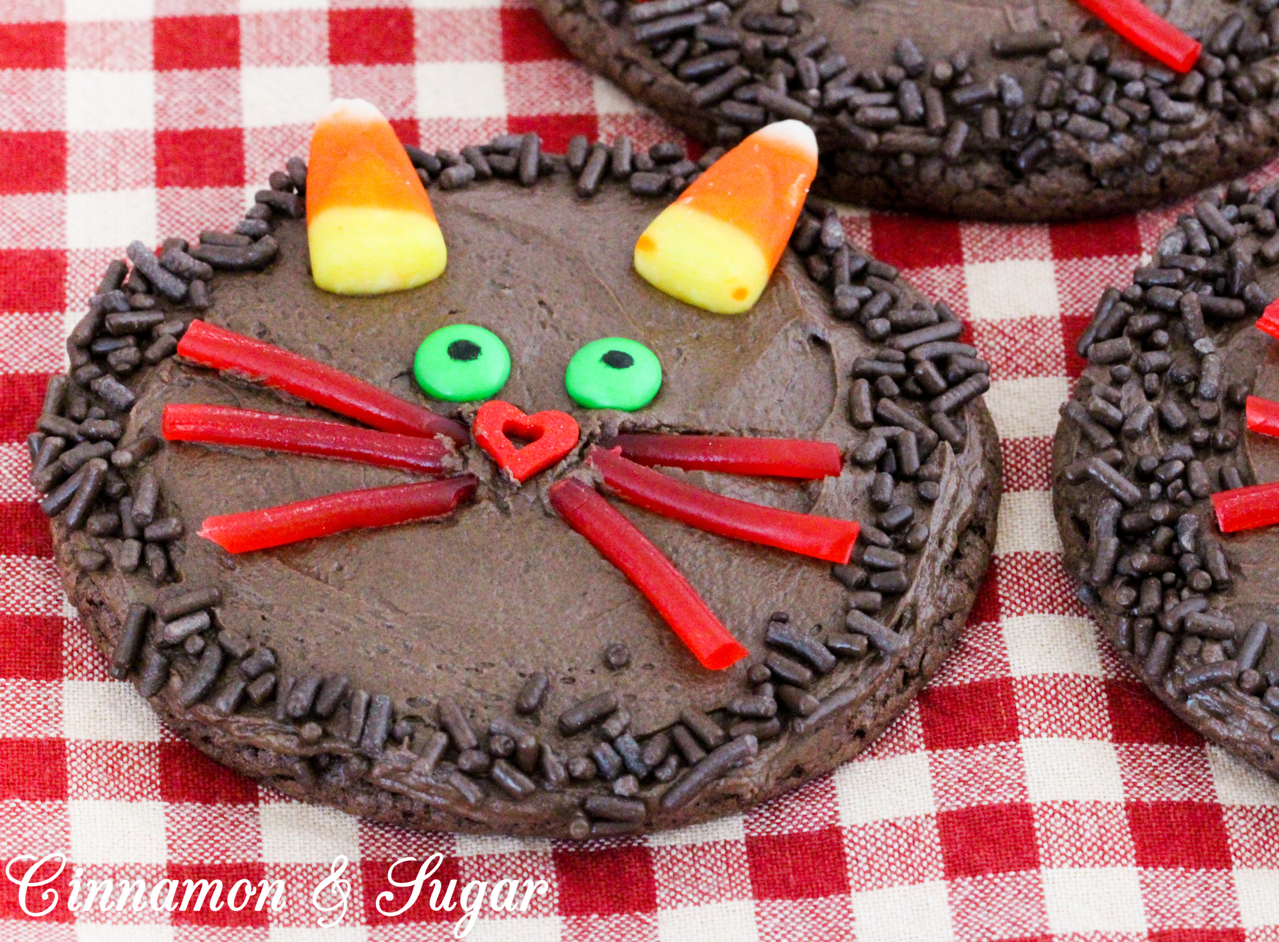 Halloween Black Cat Chocolate Cookies start with a base cookie using only 3 simple ingredients and then your ghosts and ghouls can use fun candies to create a yummy Halloween Treat! Recipe from CAKE POPPED OFF by Kim Davis.