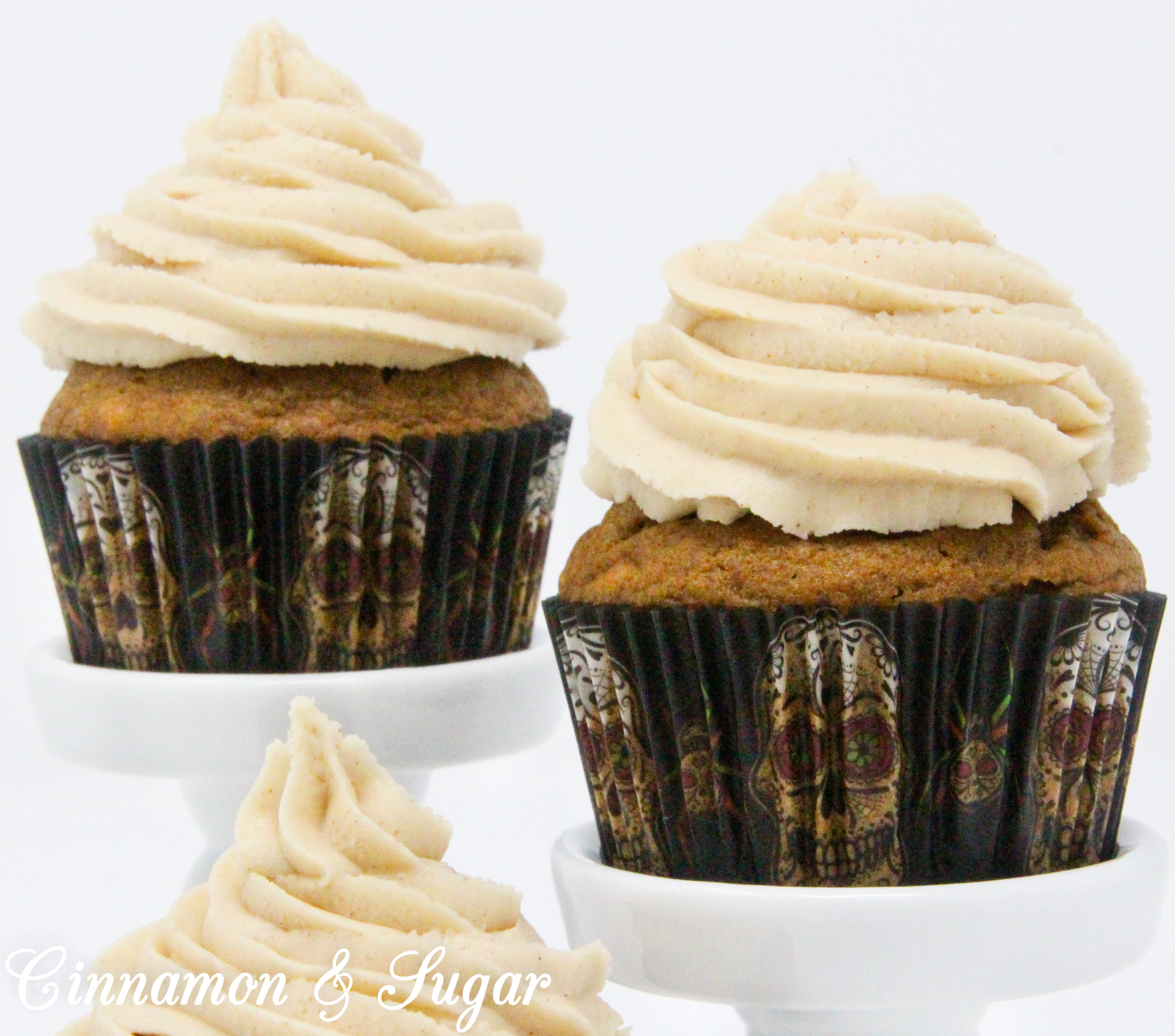 Fireball Pumpkin Spiced Coffee Cupcakes combine the flavors of fall with the bite of warming cinnamon whiskey. These cocktail cupcakes are perfect for imbibing in front of a cozy fire or sharing with friends as you celebrate autumn. Recipe created by Kim Davis, author of CAKE POPPED OFF.