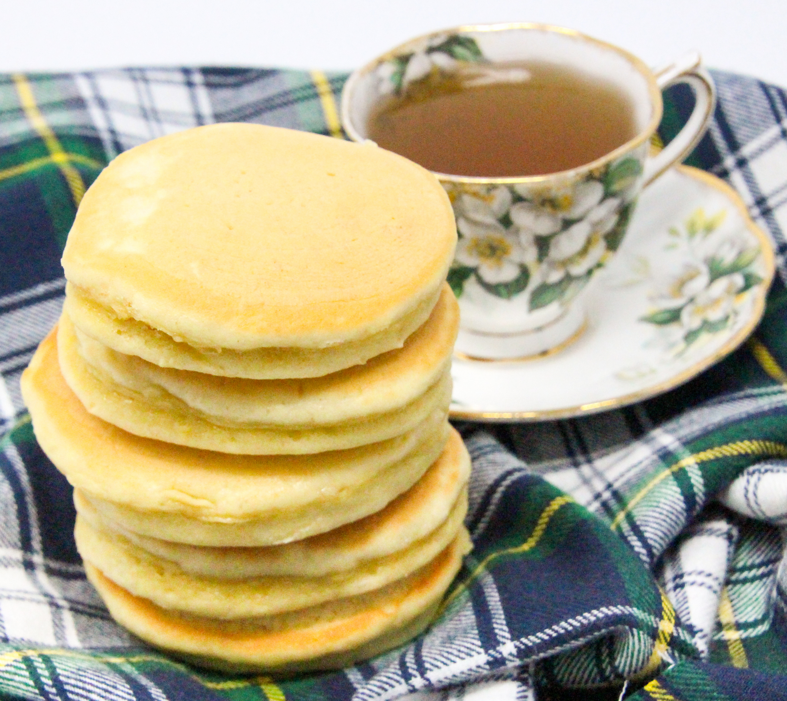 Scottish Pancakes AKA drop scones, combine a few simple ingredients to create a delicious breakfast! Sweeter than regular pancakes, these can be eaten alone with butter or topped with your favorite preserves or syrup. Recipe shared with permission granted by Paige Shelton, author of DEADLY EDITIONS.