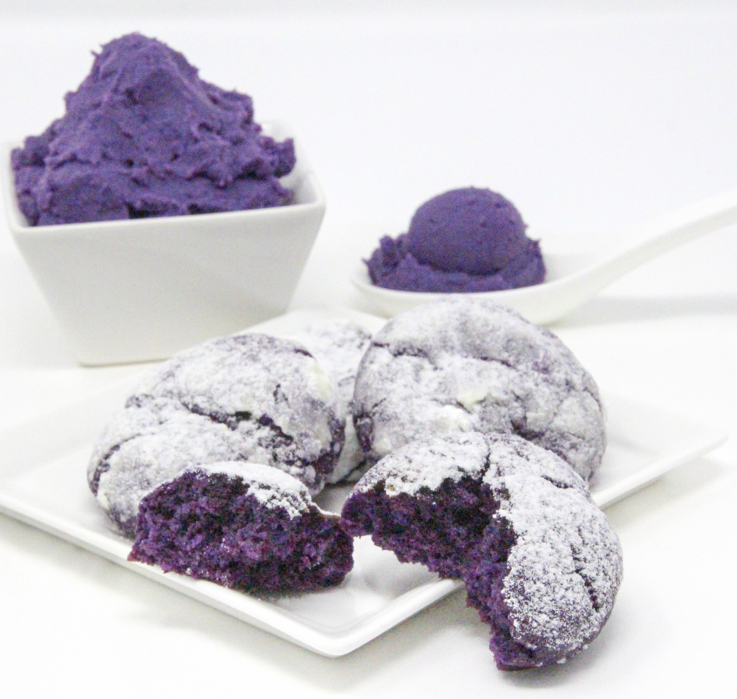 Traditional Filipino Ube Crinkles are delicious as they are unique and provide a welcome splash of color on any springtime cookie platter! Recipe shared with permission granted by Berkley Publishing, from cozy mystery ARSENIC AND ADOBO by Mia P. Manansala.