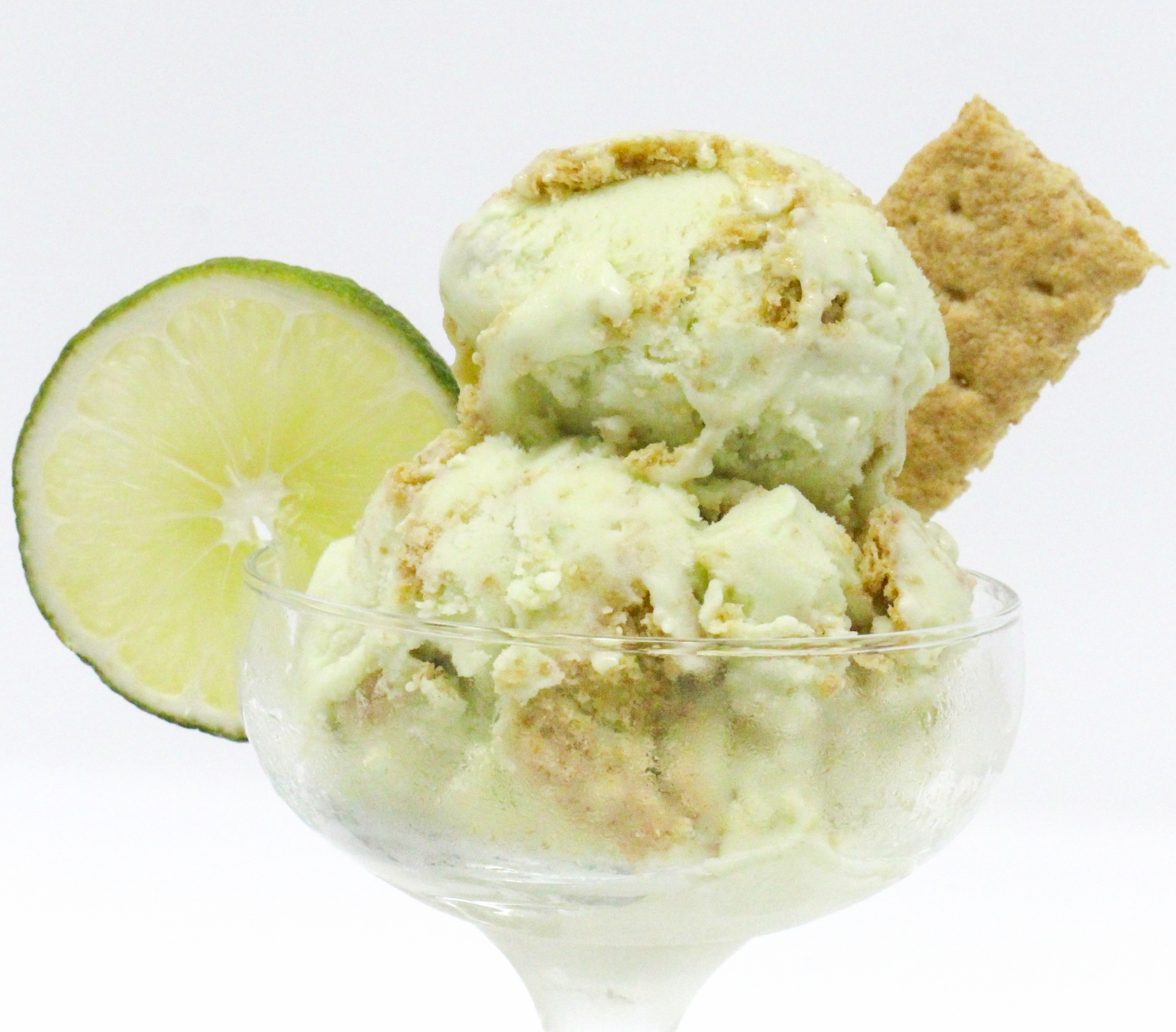 Trinidad's Easy Key Lime Ice Cream is tangy yet sweet, while the bits of graham crackers add a delicious texture to the creamy custard base. Recipe shared with permission granted by Dana Mentink, author of PINT OF NO RETURN.