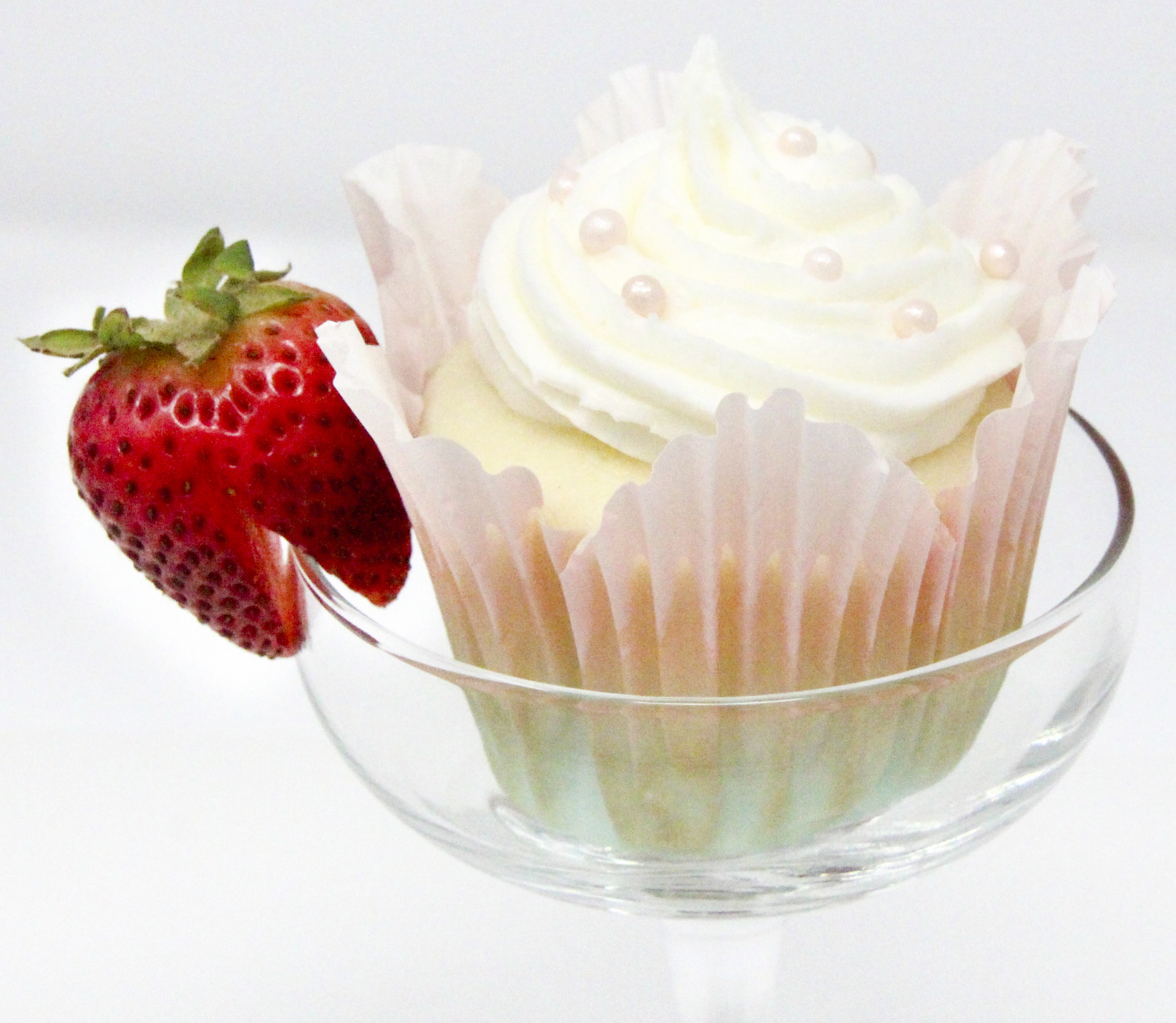 Champagne Cupcakes starts with a boxed mix (making this a quick dessert to mix up) and the champagne gives it a light, airy texture. A simply, creamy buttercream frosting makes for the perfect backdrop for any type of decoration or celebration. Recipe from FRAMED AND FROSTED by Kim Davis.