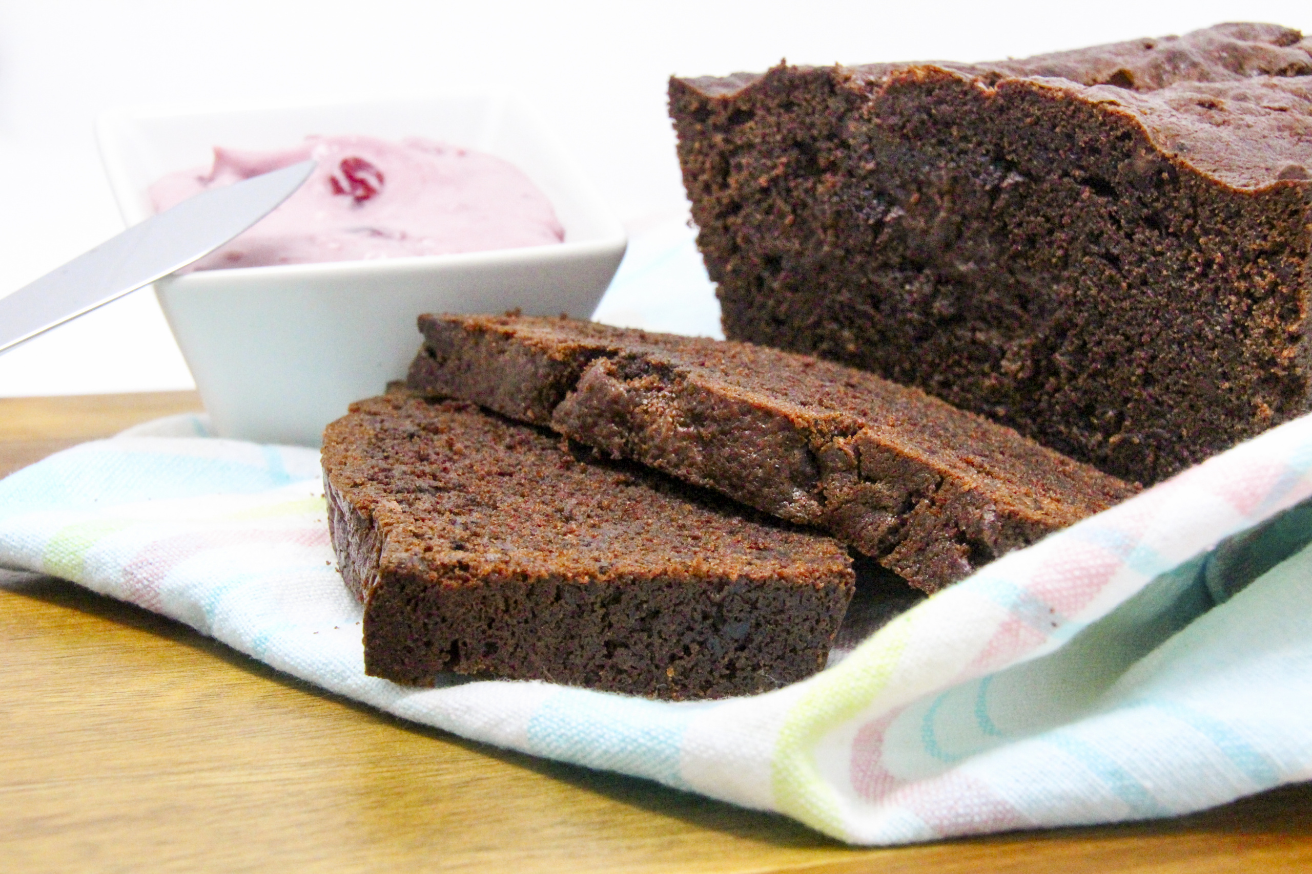 Super rich and super chocolaty, Gluten-Free Chocolate Loaf with Cherry Mascarpone Filling (or spread) ratcheted up the yum factor! A delectable treat for brunch, afternoon tea, or for anytime you feel like spoiling yourself! Recipe shared with permission granted by Libby Klein, author of BEAUTY EXPOS ARE MURDER.