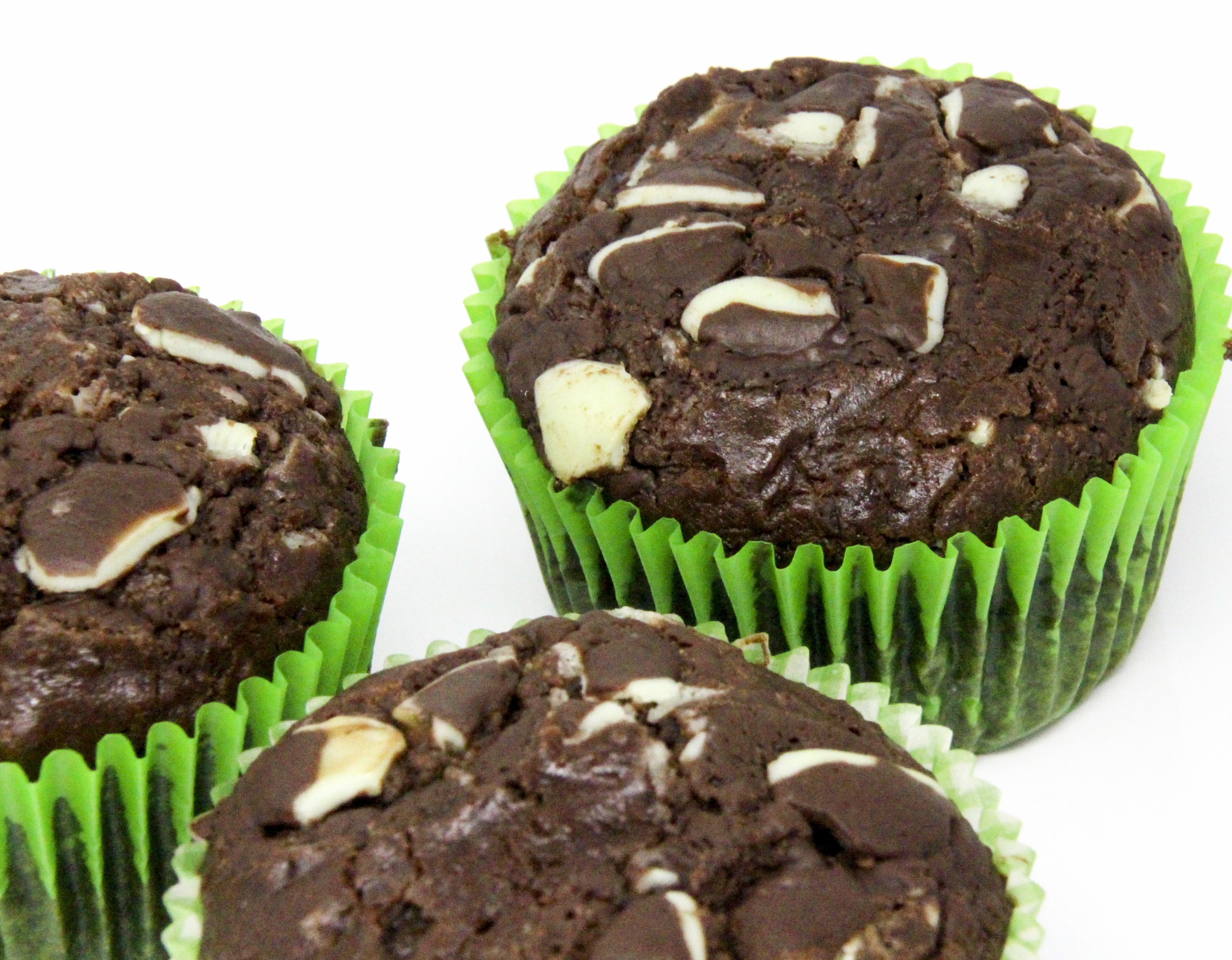 With a generous portion of of both cocoa powder and Andes Chocolate Mints, these rich Chocolate Mint Muffins could very well be classified as dessert cupcakes since they're so scrumptious! Recipe shared with permission granted by Daryl Wood Gerber, author of WINING AND DYING.
