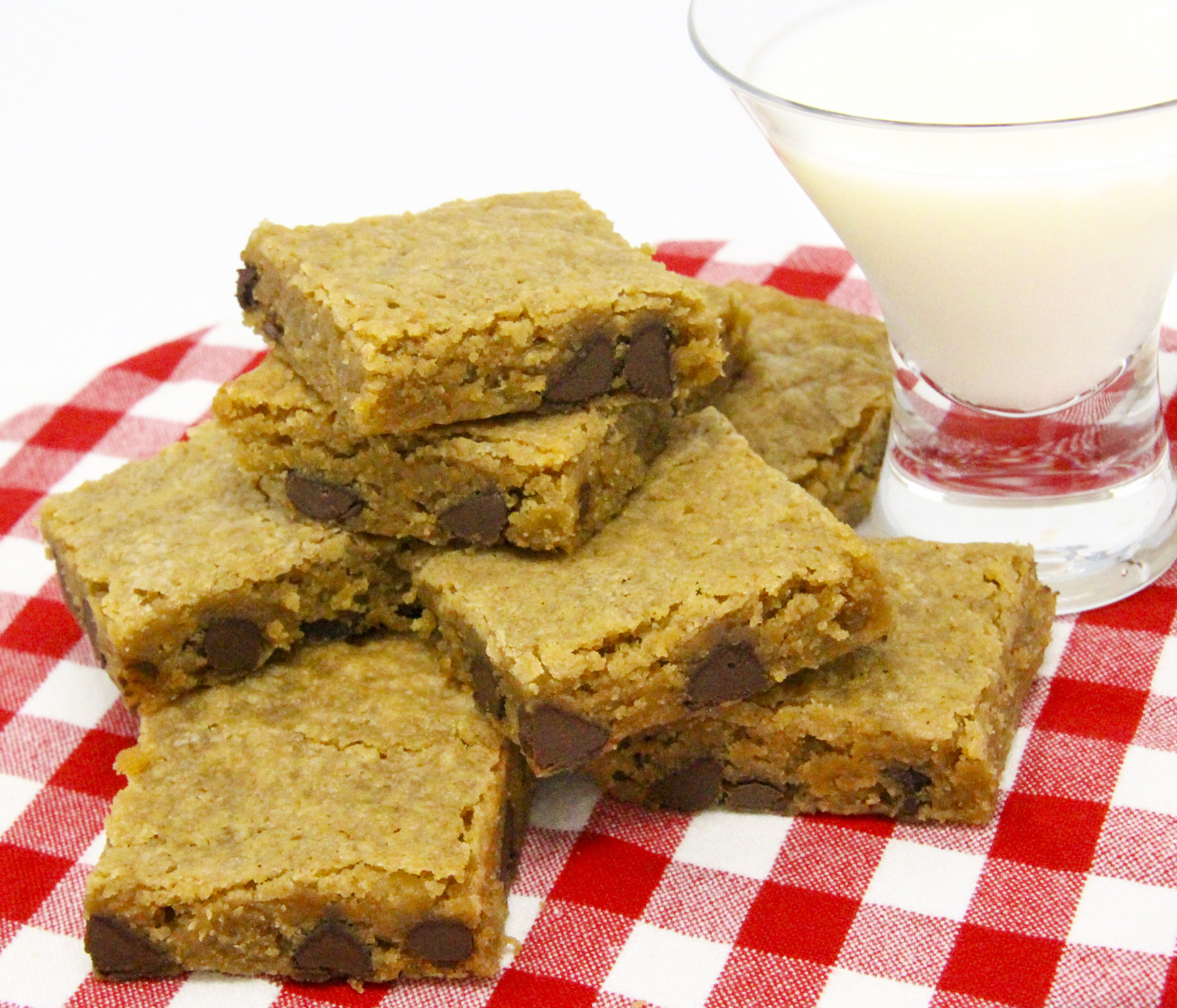Bourbon Chocolate Chip Blondies mix together quickly using pantry and dairy staples. It didn't take long for these to bake so we could enjoy the delectable combination of bourbon with the creamy sweetness of chocolate. Recipe shared with permission granted by Krista Davis, author of THE DIVA SERVES FORBIDDEN FRUIT.
