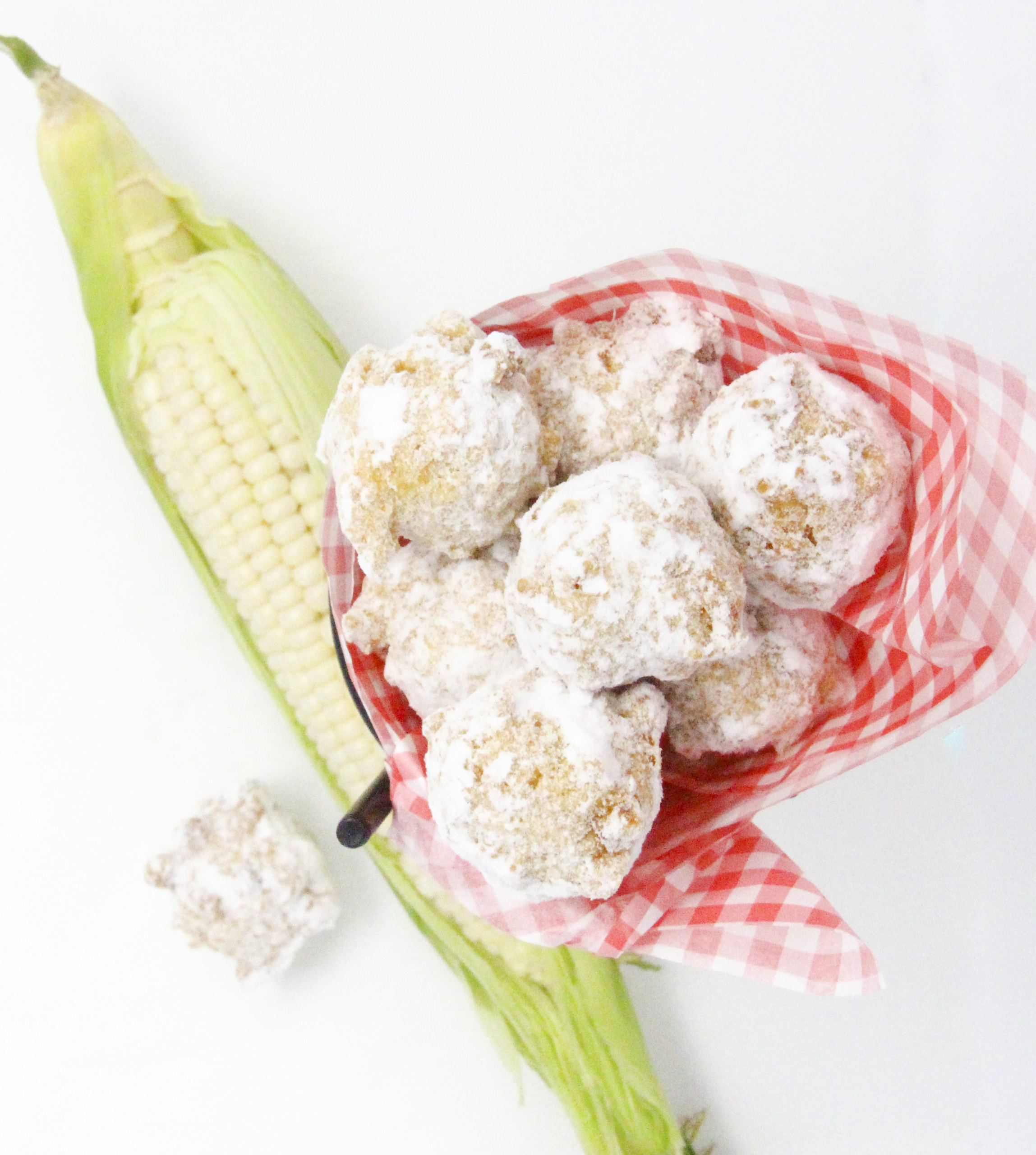 Corny Fritters can be served savory, spicy, or sweet depending on individual tastes. Fairly simple using canned or frozen corn, and a few other pantry and dairy staples, these delicious bites are quick to make. Recipe shared with permission granted by Ginger Bolton, author of BEYOND A REASONABLE DONUT.