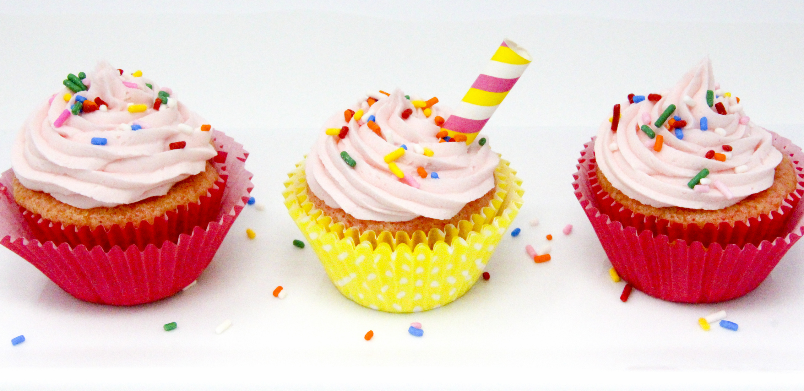 Pink Lemonade Cupcakes starts with the convenience of a boxed mix but with the addition of frozen pink lemonade, the summertime flavor shines in these tasty treats! Recipe from FRAMED AND FROSTED by Kim Davis.