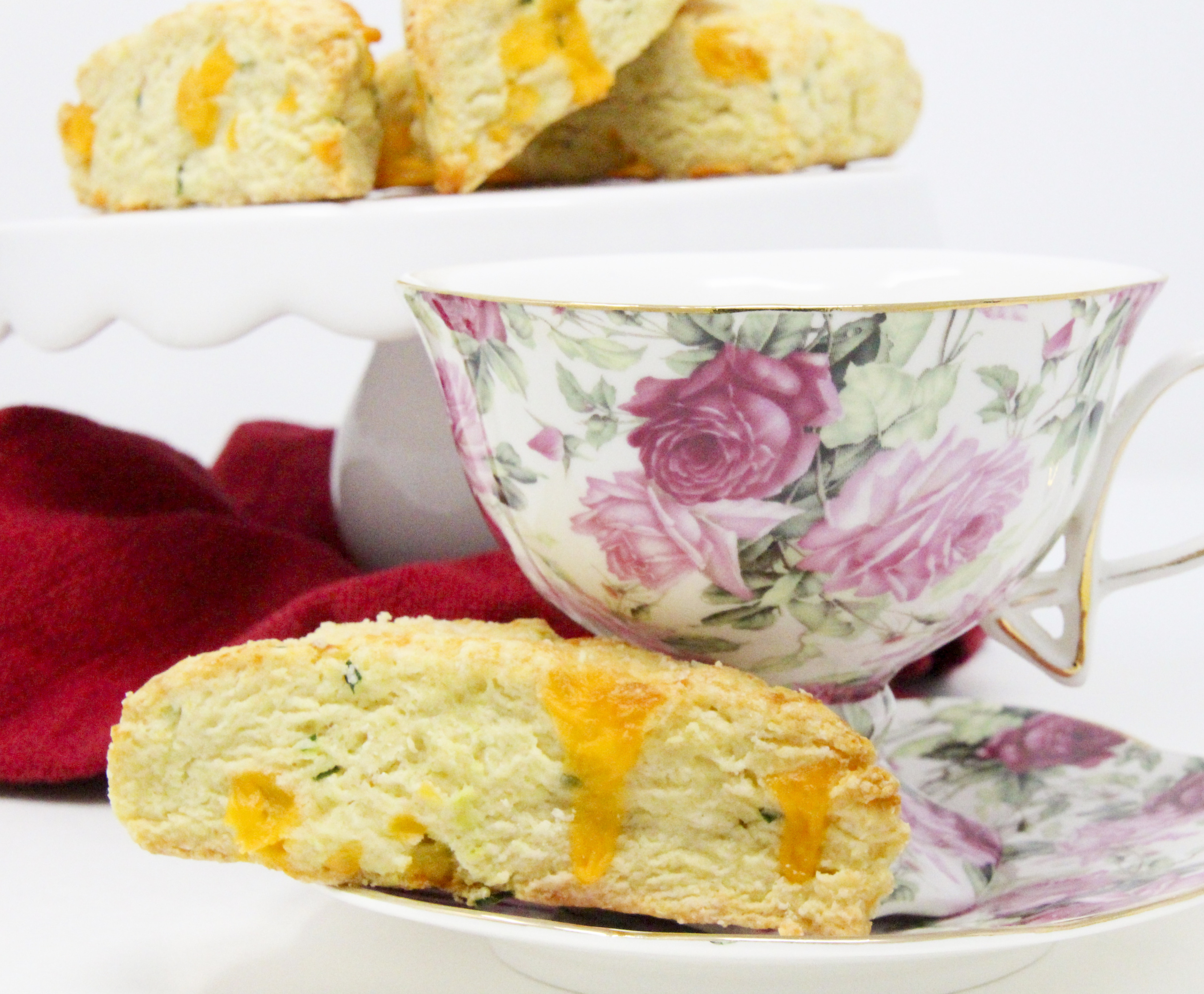 A delectable combination of flaky pastry, two kinds of cheese, and chives, Savory Cheese Scones are the perfect accompaniment to serve with a warming bowl of soup or even used as sandwich bread for lunch or a light supper. Recipe shared with permission granted by Kate Carlisle, author of LITTLE BLACK BOOK.
