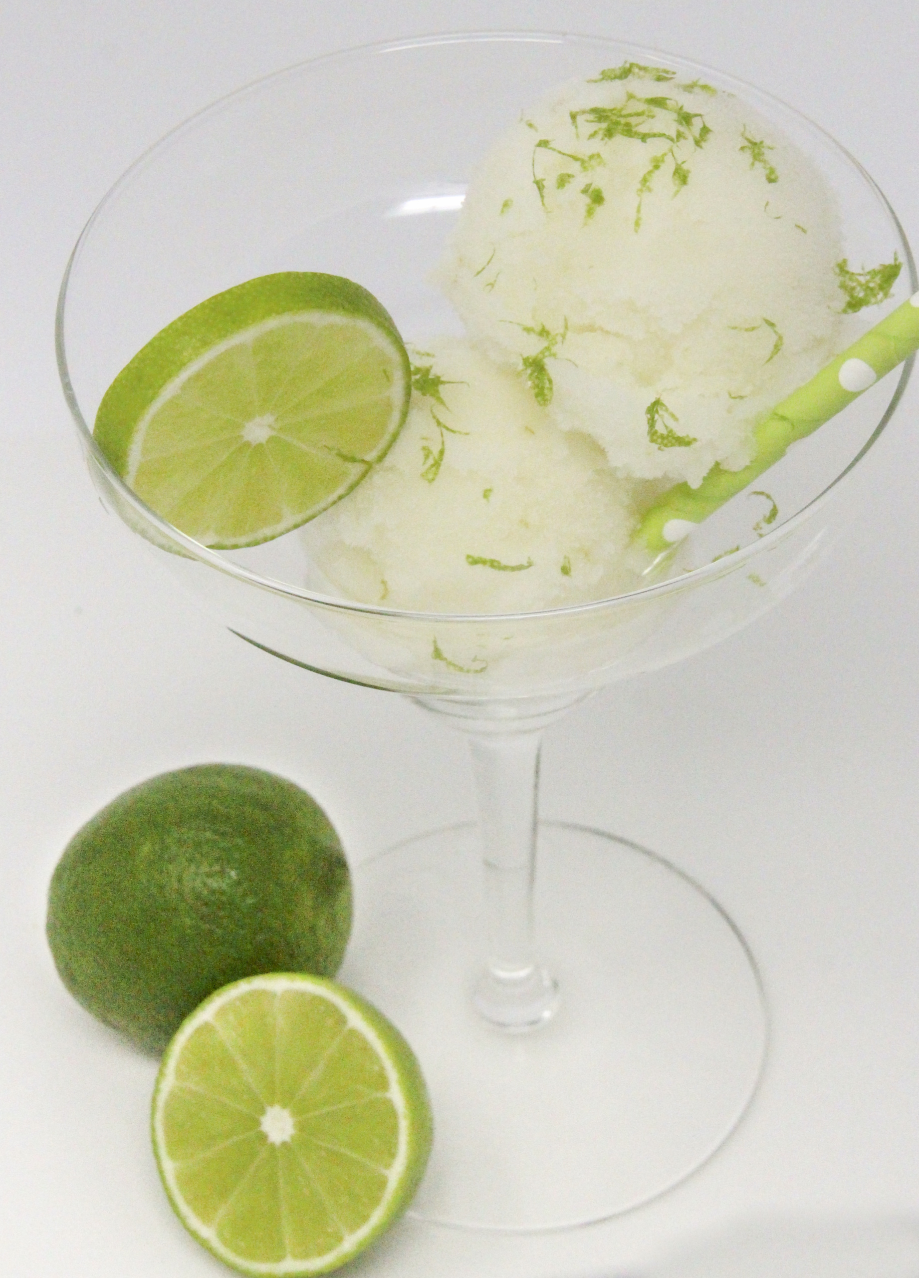 A tart-sweet lime sorbet with a kick from tequila and triple sec, this Ultimate Frozen Margarita captures the essence of summer! Recipe shared with permission granted by Meri Allan, author of THE ROCKY ROAD TO RUIN.