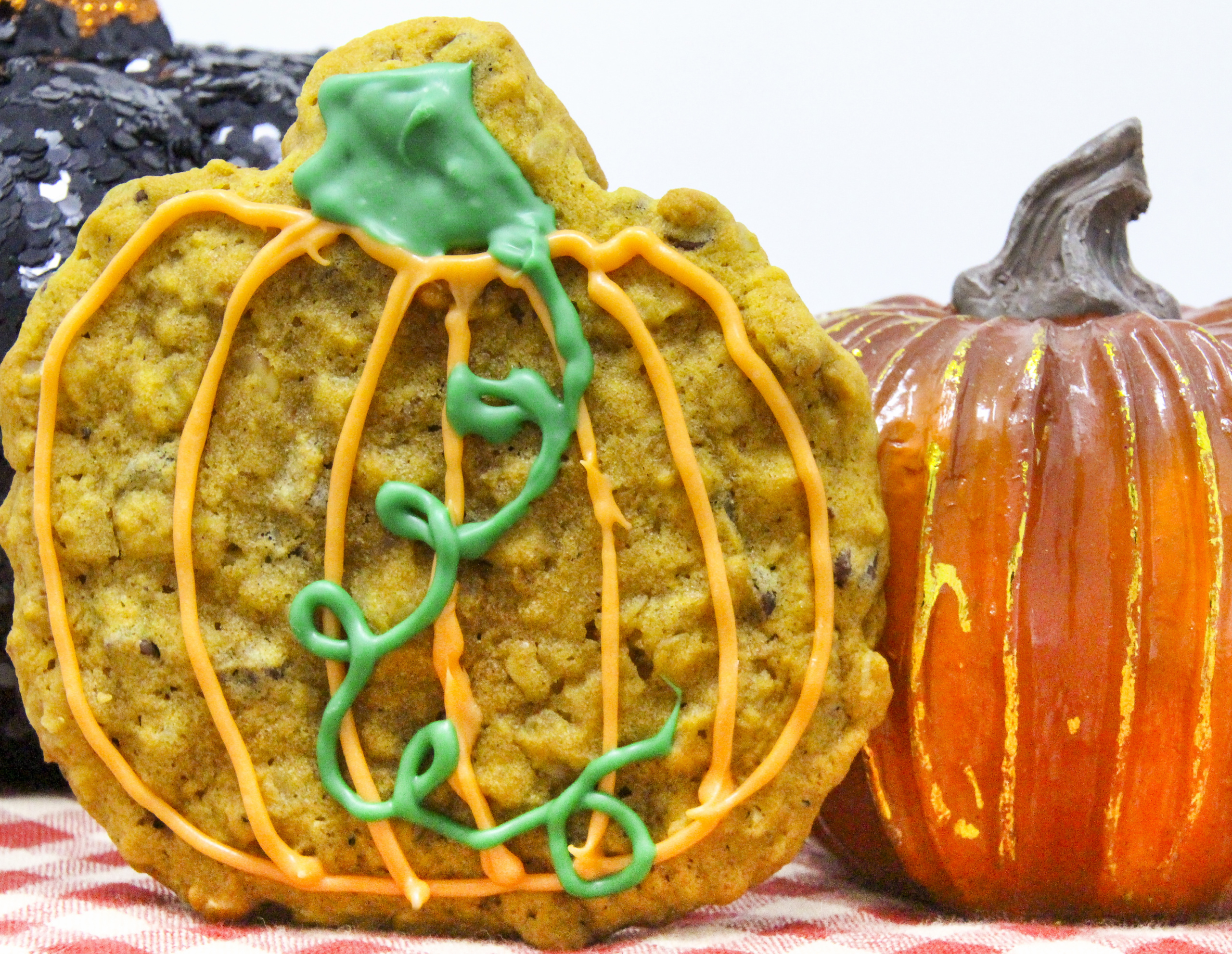 Full of flavor, these Gluten-Free Pumpkin cookies are pumpkiny and spicy, chocolately and cakey, yet moist with a crunch from the walnuts added. Recipe shared with permission granted by Barbara Ross, author of Halloween Party Murder.