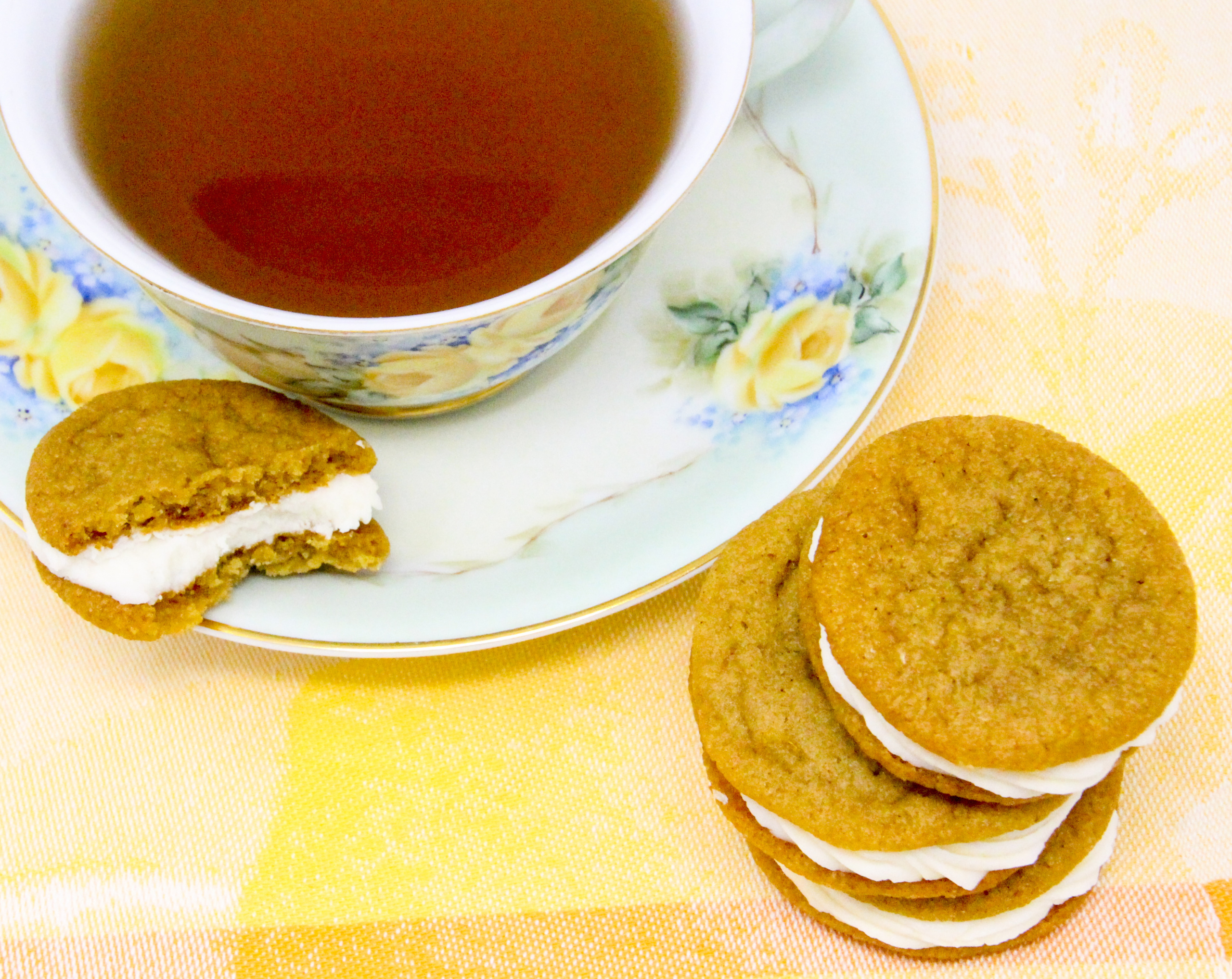 Chockful of flavor, these Lemon-Ginger Sandwich Cookies are a bit crunchy on the edges and soft and sweet on the insides. Perfection in each bite! Recipe shared with permission granted by Darci Hannah, author of MURDER AT THE CHRISTMAS COOKIE BAKE-OFF.
