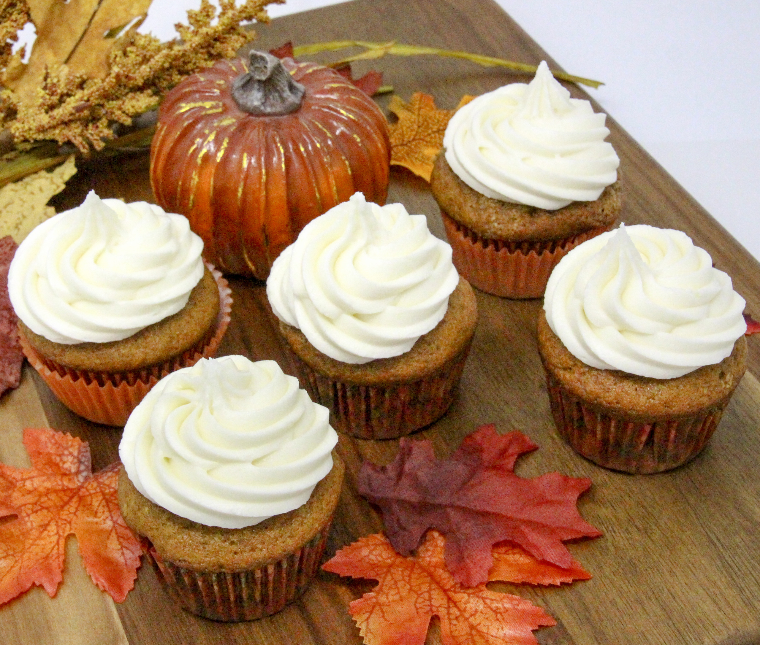 Rich and moist, the warm flavors of these Pumpkin Cupcakes with Cream Cheese Frosting hits the mark for bringing to mind chilly fall days and looking forward to jack-o-lanterns and trick-or-treaters. Recipe shared with permission granted by Krista Davis, author of MURDER OUTSIDE THE LINES.
